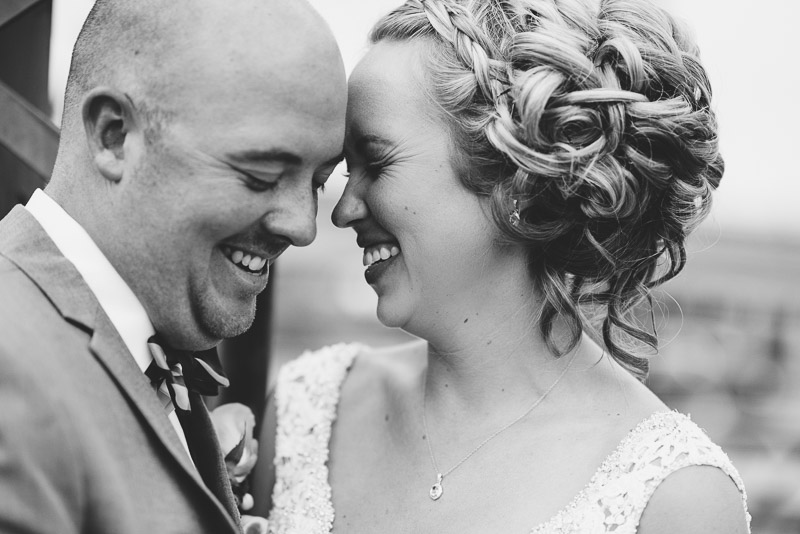 Denver athletic club wedding laughing bride and groom black and white