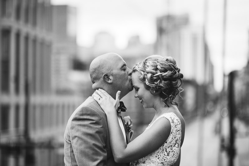 Denver athletic club wedding classic kissing black and white