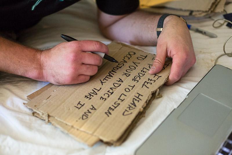 Lake Tahoe Wedding Photographer writing vows on cardboard