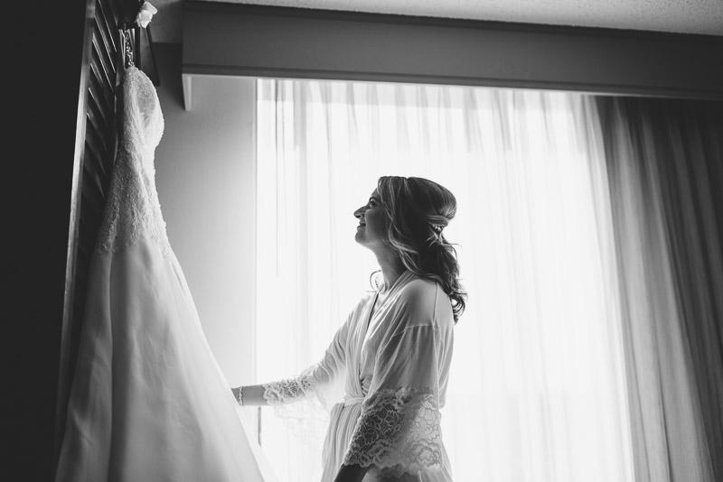 San Jose wedding photography bride looking at dress