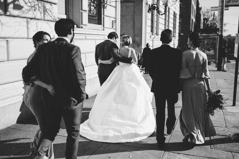 bridal party walking down san francisco street