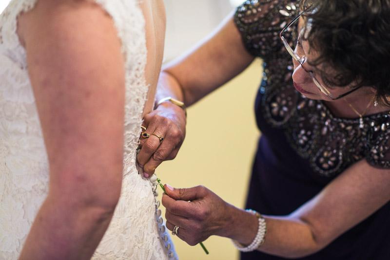 San Francisco Wedding Photography Villa Chanticleer mother helping bride with dress