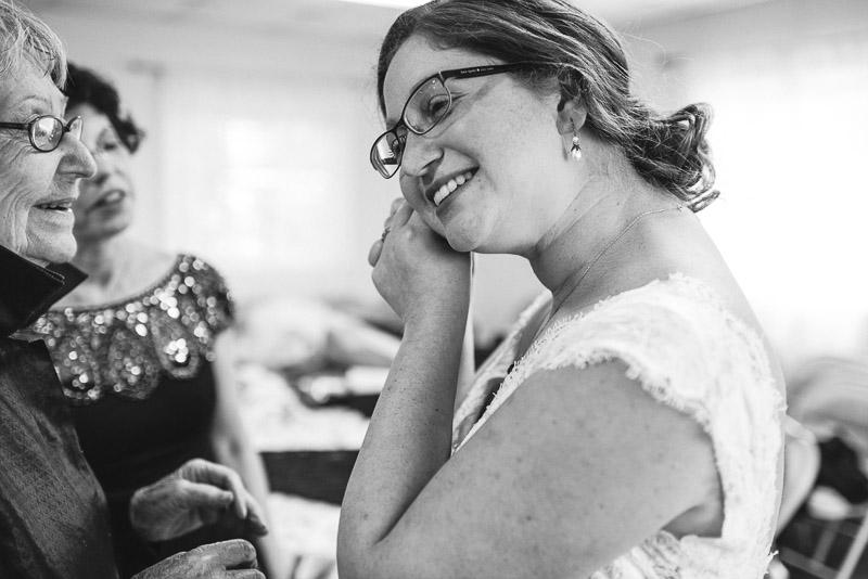 San Francisco Wedding Photography Villa Chanticleer bride putting on earrings