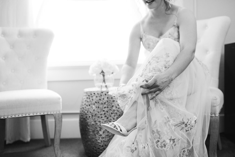 deer park villa wedding photography bride putting on shoes