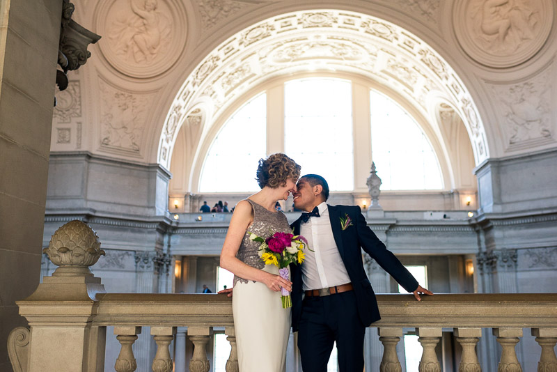 san francisco city hall wedding kissing couple