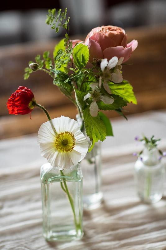 Strauss home ranch wedding flowers in antique bottles