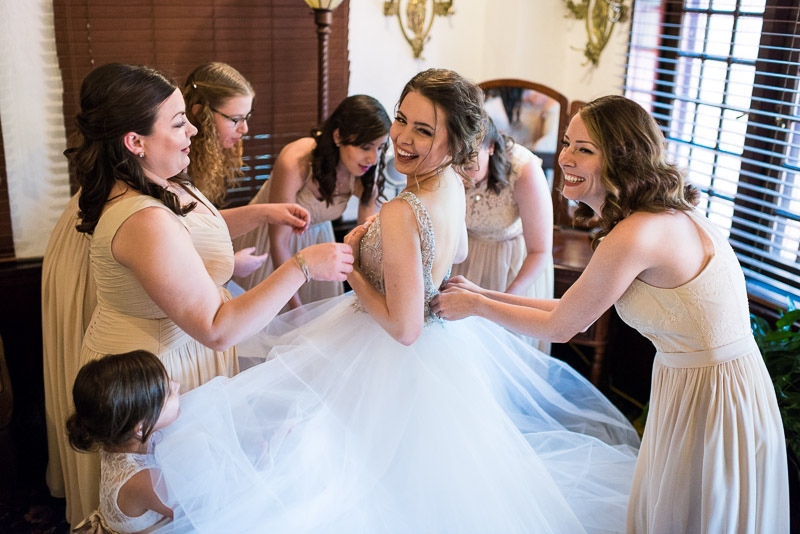 Denver Wedding Photography Wellshire Inn laughing bride getting dressed