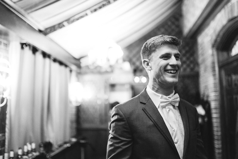 Denver Wedding Photography Wellshire Inn groom laughing