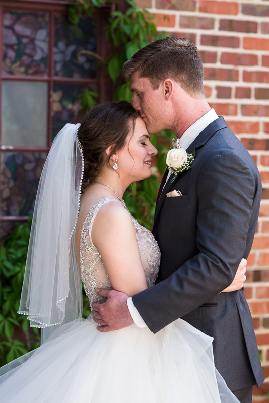 Denver Wedding Photography Wellshire Inn couple kissing first look