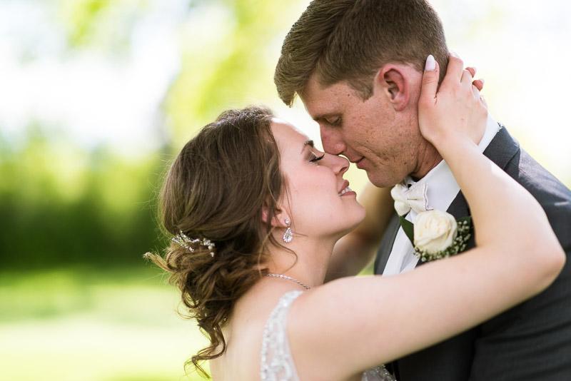 Denver Wedding Photography Wellshire Inn kissing couple