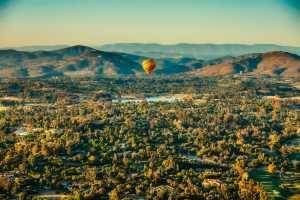 New Mexico - Balloon over village - John Burton Ltd NZ