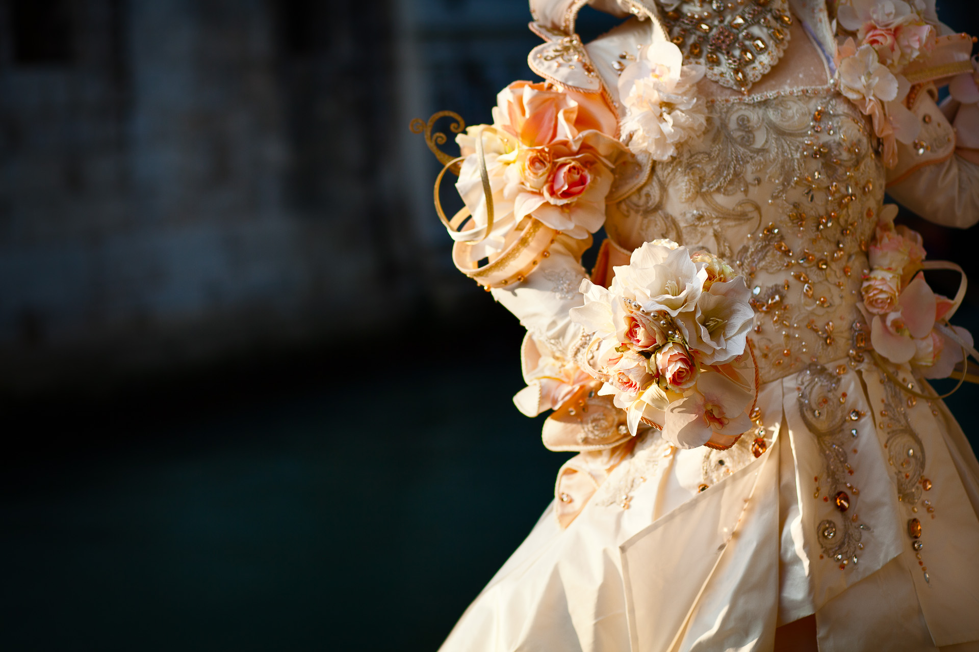 Venice Carnival 2012, woman in costume by a canal