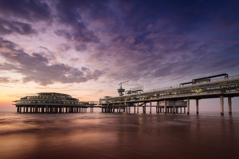 Image of the Scheveningen pier in The Hague at sunset
