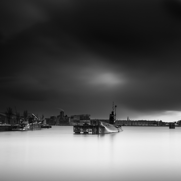 Long exposure black and white image of a soviet Zulu V class B-80 submarine in the Amsterdam harbour