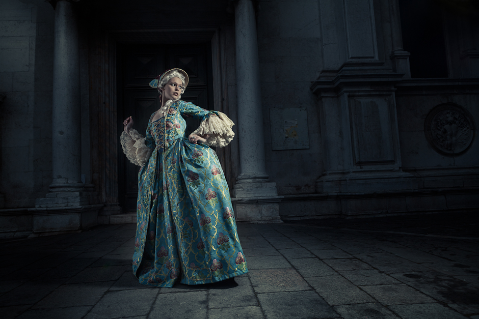 Image of woman in 17th century costume running away from the light