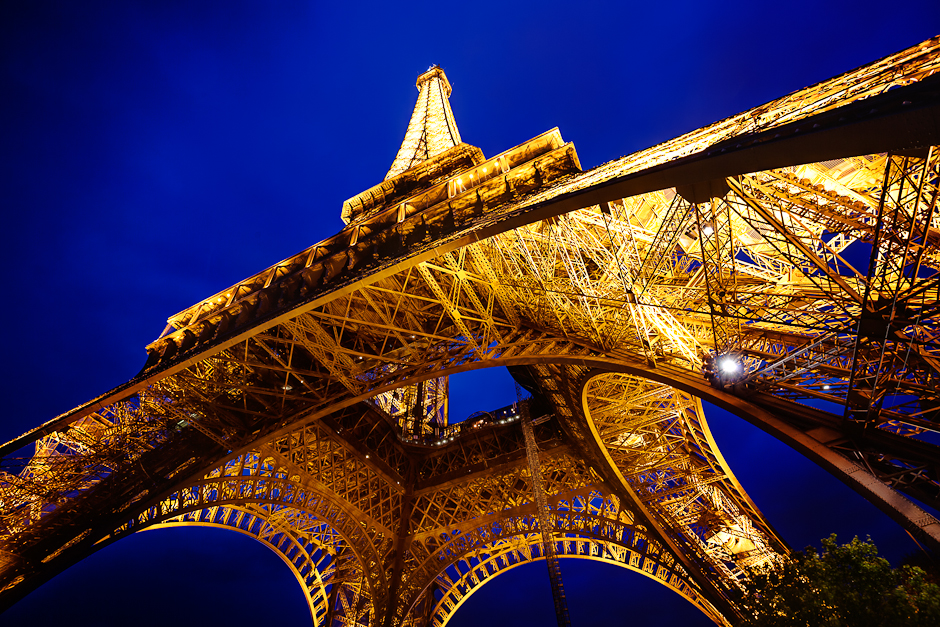 A photograph of The Eiffel Tower from below just after sunset during blue hour