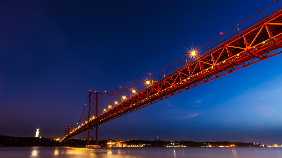 A photograph of the 25th of April Bridge in Lisbon, Portugal