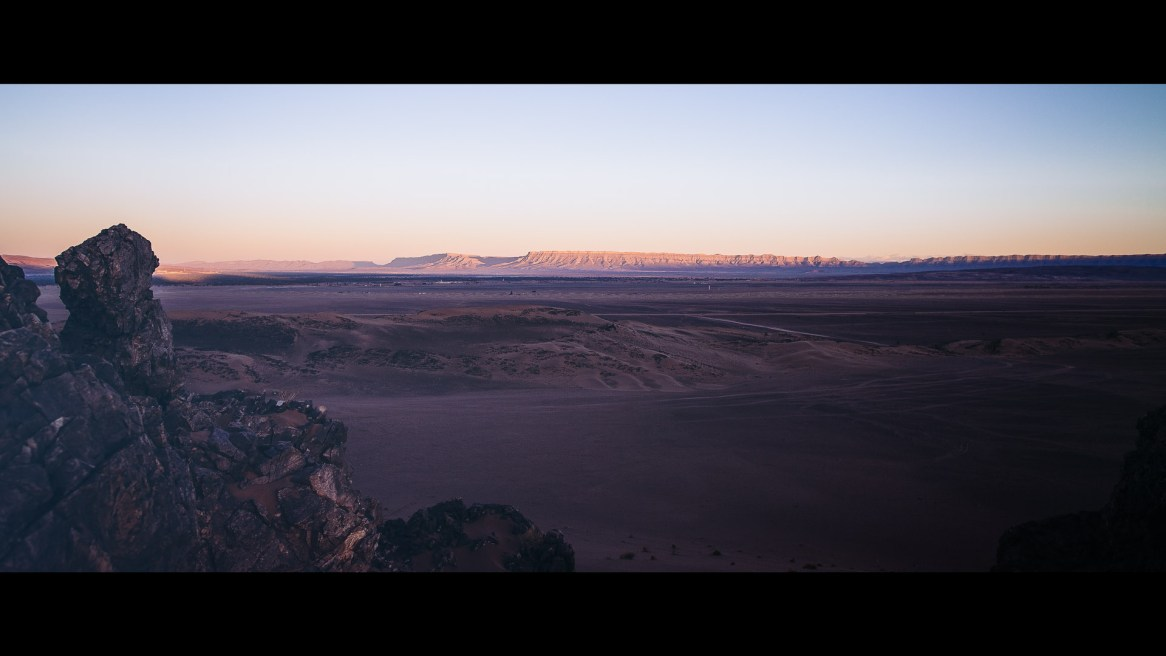 Looking down into the desert camp at sunrise