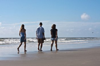 Walking on the beach has more health benefits than just fun.