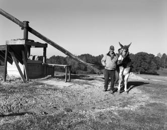 11-2014 Jerry Brown Potter and Ole Blue-turning clay the traditional way. Pentax 6x7-55mm lens-K2 filter-Ilford Delta 100 120 film-PMK Pyro developer.