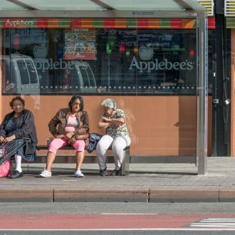 The Bus Stop, Harlem, by John Dowell artist photographer