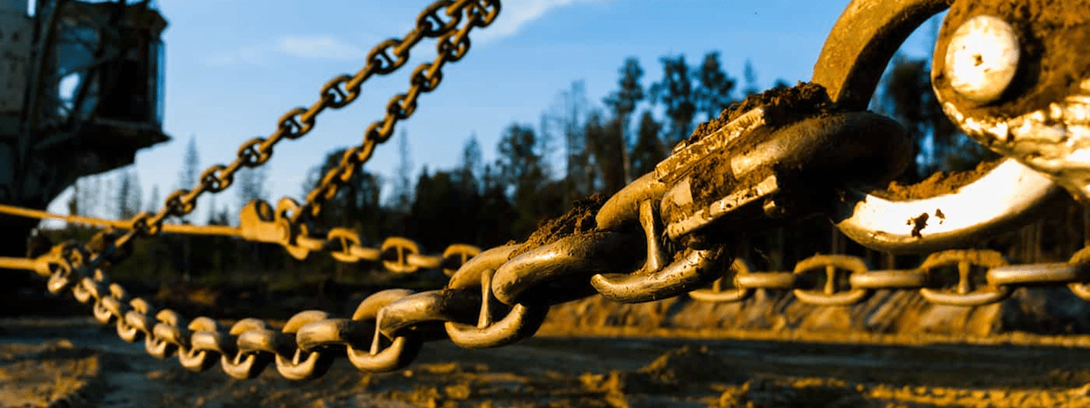 Chains and crane on construction site