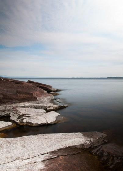 A long exposure settles the waves at Oak Ledge Park in Burlington, Vt