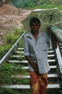 Some Sri Lankans use the railroad track as other means of transportation.