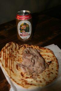Italian stadium food: porchetta and a beer.