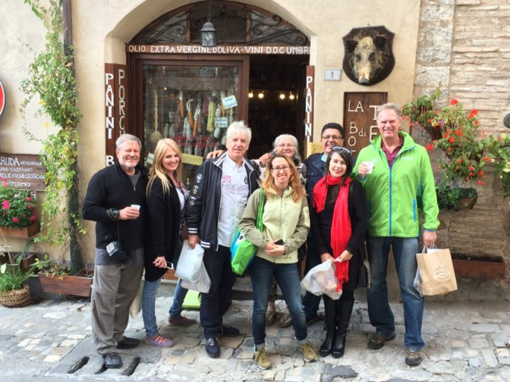 The gang at the end in front of La Bottega Di Teresa in Spello, Teresa is back row, third from right.