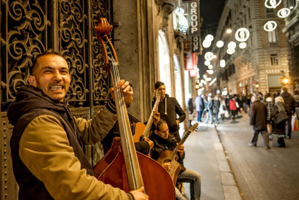 "This trio of Bulgarians played ""Jingle Bells"" on Via del Corso. Photo by Marina Pascucci"