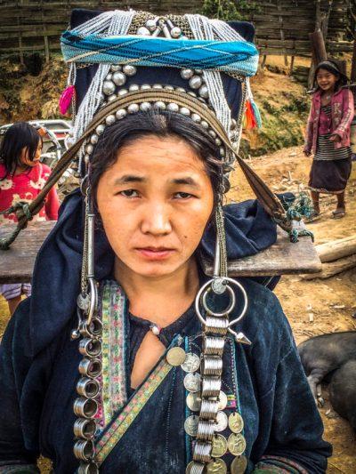 A woman's headdress indicates her marital status.