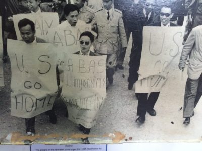 A photo from the Lao National Museum of street protests in Vientiane during the '70s.