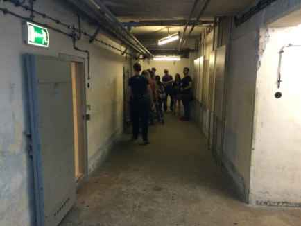 A hallway with some of the 200 interrogation rooms.