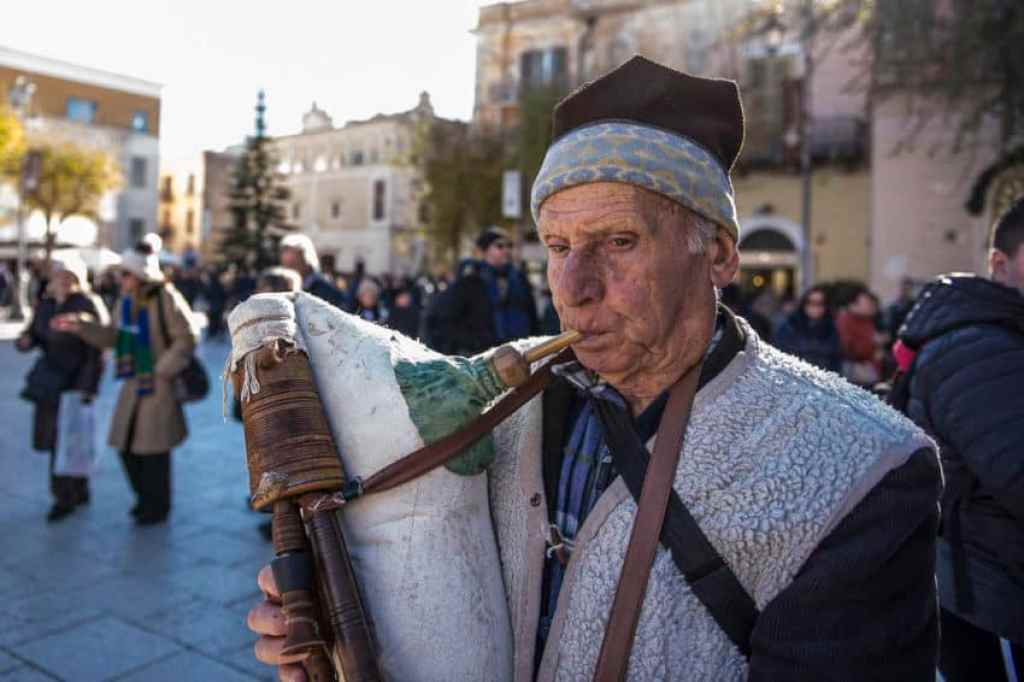 A man plays a zampogna, a traditional Basilicata instrument often played around Christmas and around Italy in folk music festivals. Photo by Marina Pascucci
