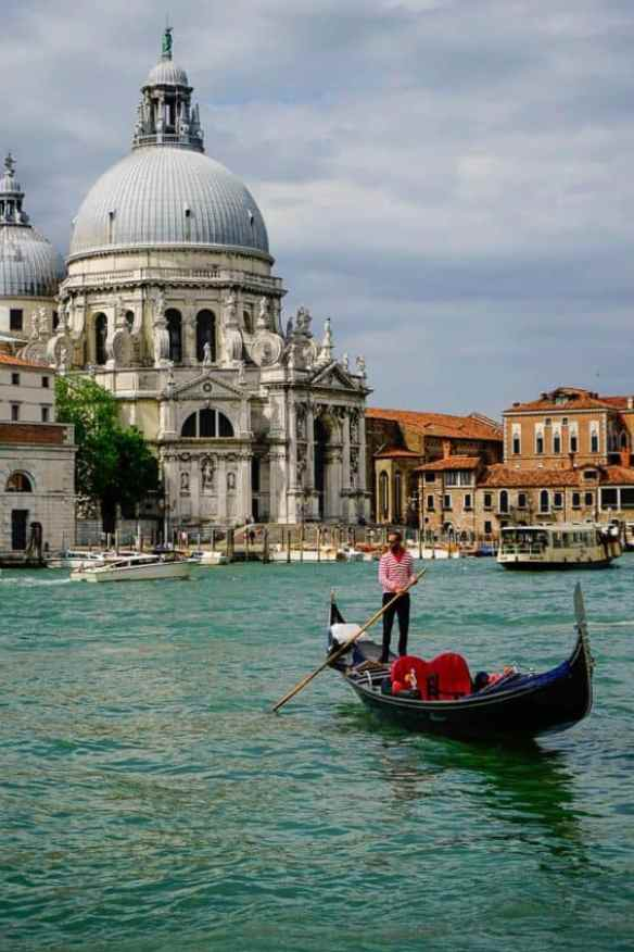 A lone gondolier paddles up the Grand Canal. Photo by Marina Pascucci