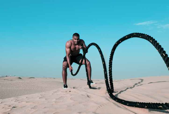 man holding exercise rope