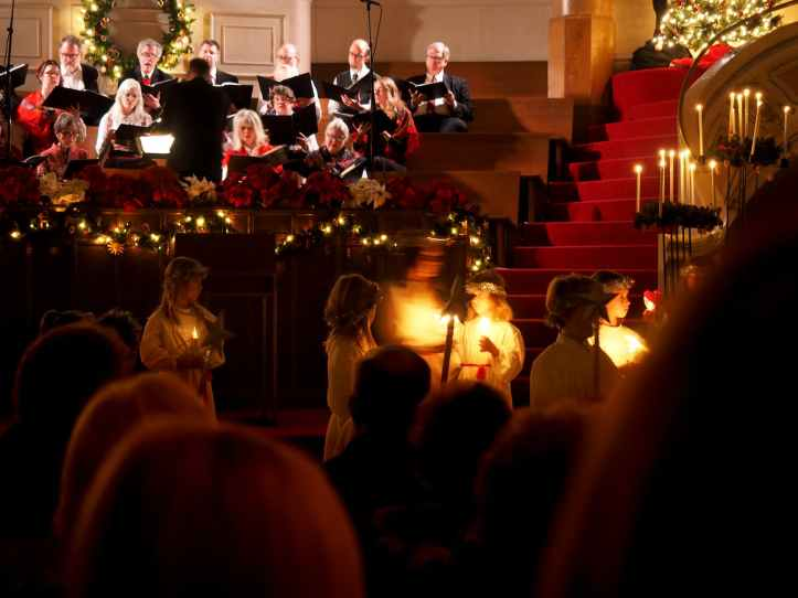 people standing inside church christmas