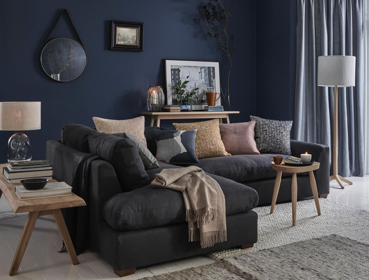 living room colours to go with grey sofa small design ideas on a budget the subtle art of how dress cushions and throws dark in blue
