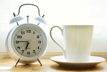 Alarm clock and cup of tea