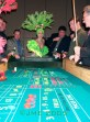 a picture of las vegas showgirls playing craps