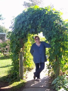 My sister stands in the archway along the pathway to the Bottle Chapel.