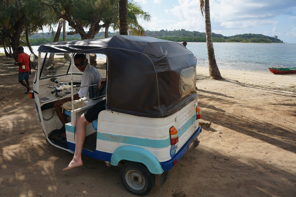 Getting picked up in our tuktuk to go diving