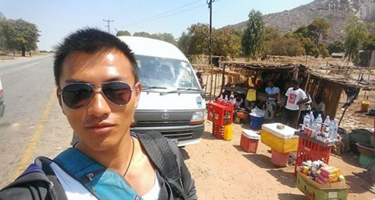 Selfie on the side of the road in Nampula, waiting for my chappa (in the back) to fill up. Refreshments and food available for purchase!