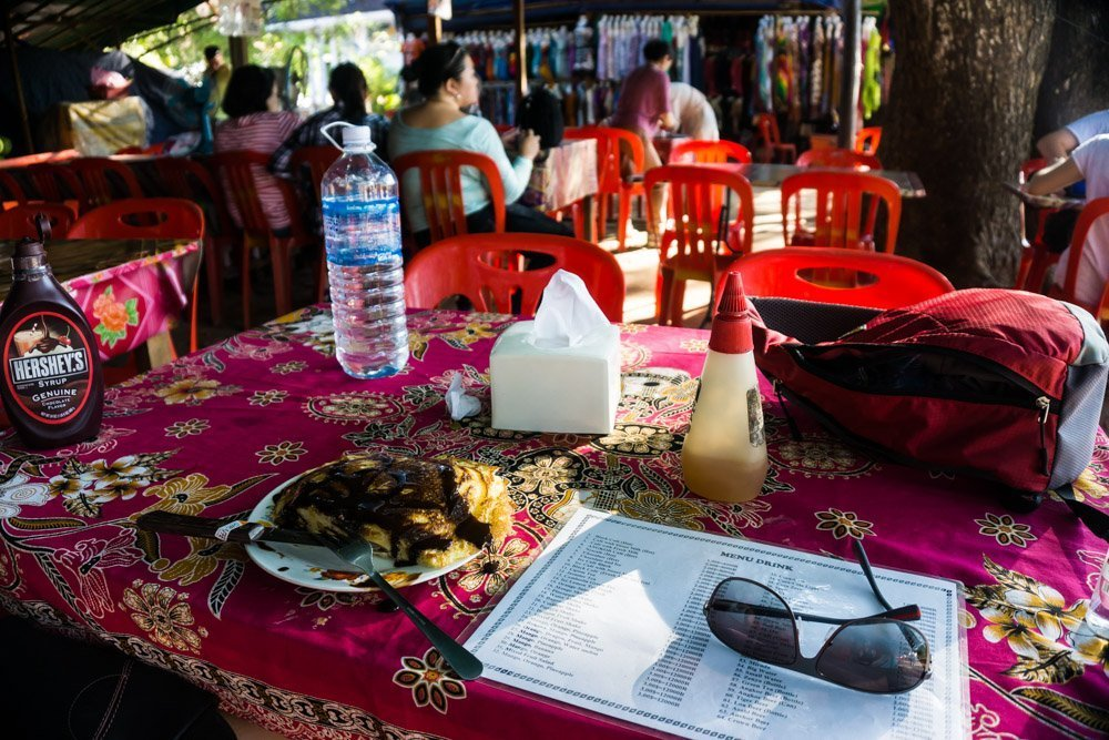 Enjoying Amok and chocolate pancakes after a few hours in Angkor Wat.