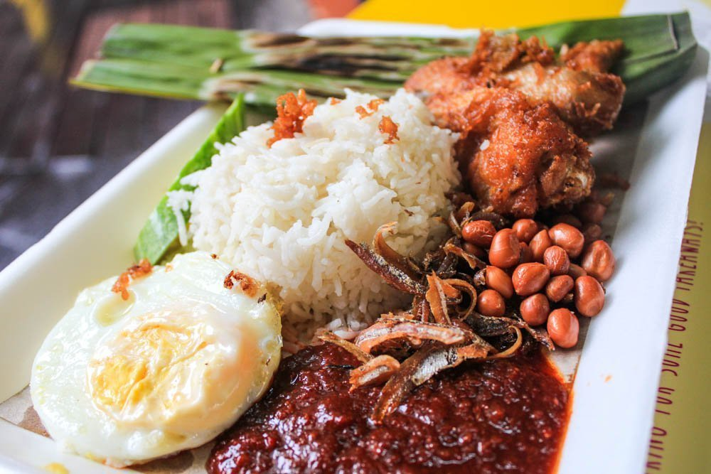 Nasi Lemak: A typical Malay dish that was largely a breakfast dish but recently made into lunch and dinner as well. It's typically wrapped in a banana leaf, and served with chicken, egg, cocunut rice, and most importantly a good sambal sauce. I was absolutely obsessed with this dish and ate it on a daily basis when I went to Malaysia.