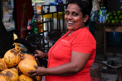 Polonnaruwa-buying-coconut-woman