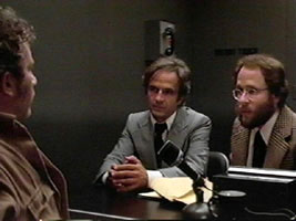 """Left to Right; """"Roy Neary"""" played by Richard Dreyfuss, """"Claude Lacombe"""" played by François Truffaut and """"David Laughlin"""" played by Bob Balaban."""