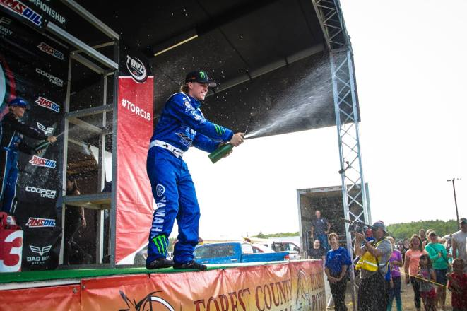 CJ Greaves celebrate his first Pro Stock UTV win at Crandon International Raceway.