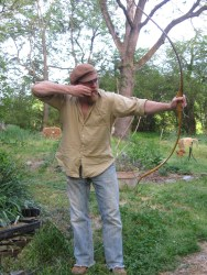 drawing a snakeskin backed osage bow